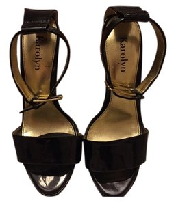Karolyn Black and gold Pumps