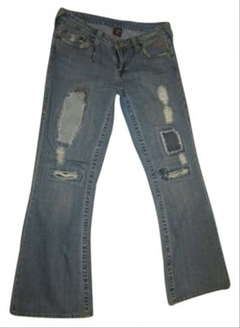 Preload https://item5.tradesy.com/images/true-religion-faded-blue-wash-w-patches-distressed-limited-edition-with-denim-patch-details-flare-le-131559-0-0.jpg?width=400&height=650
