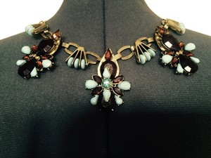 Other NECKLACE with colored Flowers in Amber, Brown and Turquoise.