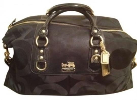 Preload https://item1.tradesy.com/images/coach-12959-madison-duffle-sabrina-black-signature-jacquard-op-art-c-s-leather-weekendtravel-bag-131815-0-0.jpg?width=440&height=440