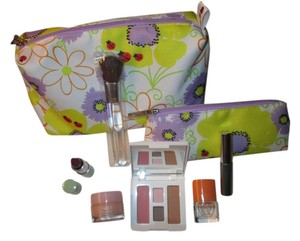 Clinique Brand new Clinique bundle includes cosmetic bag, makeup and Clinique Happy fragrance!!