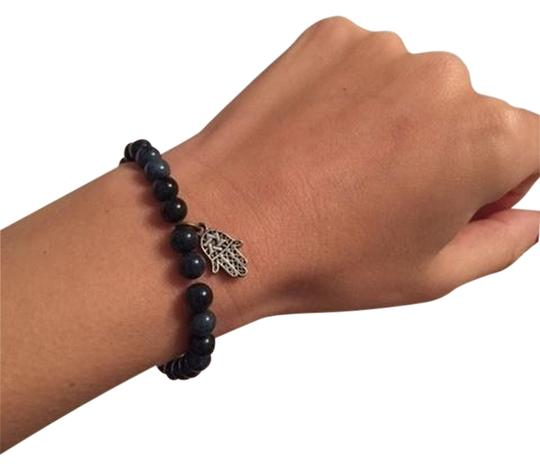 Preload https://item1.tradesy.com/images/unknown-beaded-bracelet-with-silver-hamsa-charm-1318840-0-0.jpg?width=440&height=440