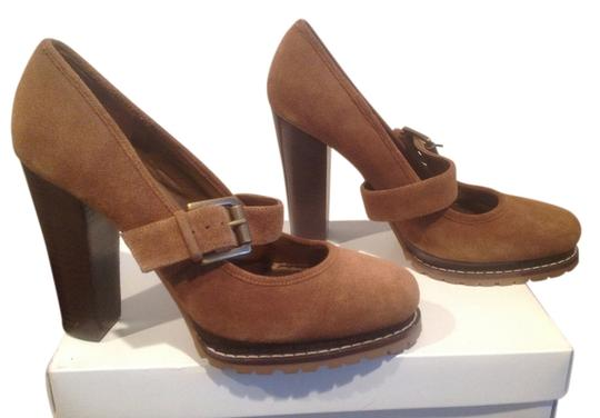 Preload https://item5.tradesy.com/images/bcbgeneration-brown-suede-stacked-wood-layer-and-heels-adjustable-foot-strap-platforms-size-us-9-reg-1320664-0-0.jpg?width=440&height=440