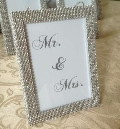 Preload https://item5.tradesy.com/images/silver-rhinestone-mr-and-mrs-5x7-frame-reception-decoration-132094-0-0.jpg?width=440&height=440