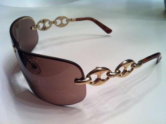 Preload https://item2.tradesy.com/images/gucci-brown-shield-sunglasses-132356-0-0.jpg?width=440&height=440