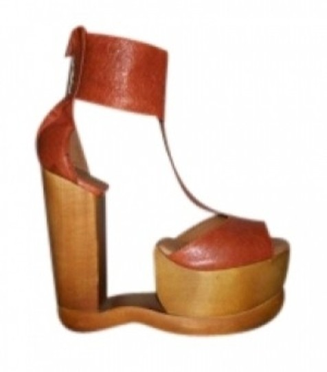 Preload https://item3.tradesy.com/images/jeffrey-campbell-rust-orange-archless-t-strap-leather-wooden-wedge-sandal-platforms-size-us-8-132607-0-0.jpg?width=440&height=440