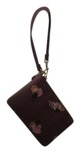 Coach Canvas Wristlet in purple with flowers