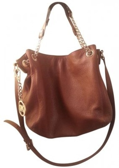 Preload https://item4.tradesy.com/images/michael-kors-jet-set-chain-brown-leather-tote-132728-0-0.jpg?width=440&height=440