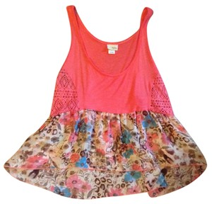 Daytrip Top Coral with a floral design