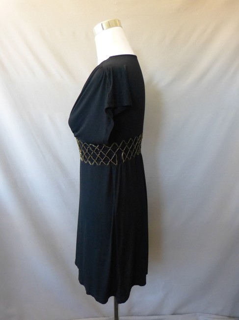 Nikibiki short dress Black Gold Stitched Elastic Waist Dolman on Tradesy