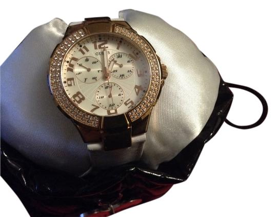 Guess modern guess watch with crystals all around it