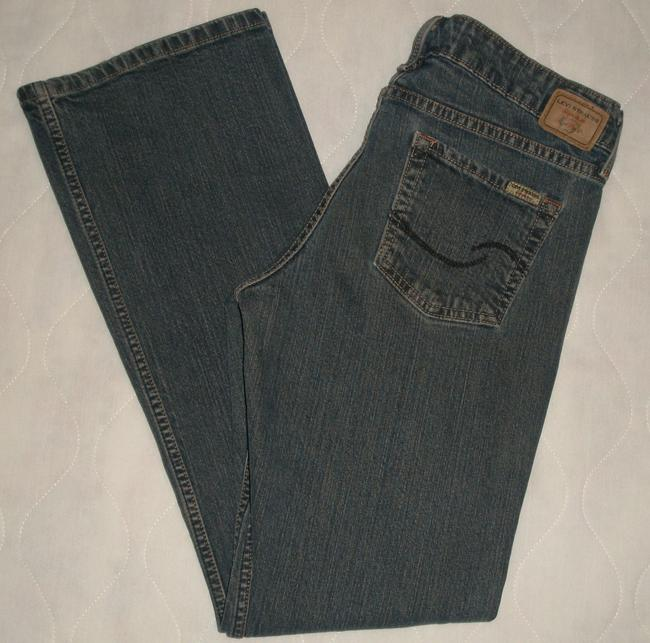 Levi's Classic 5 Pocket Style *zip Fly Leg Opening *low Rise *marking & Slight Distressing Detail Cotton/Spandex *machine Boot Cut Jeans-Medium Wash