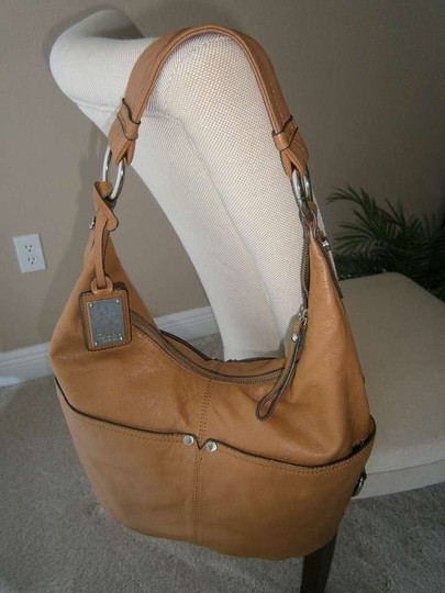Tignanello Glove Leather 2 Front & 2 Rear Deep Open Pockets 2 Inside Pockets 1 Inside Zip. Tote in British Tan