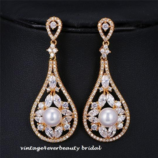 Preload https://item2.tradesy.com/images/gold-luxury-plated-cz-pearl-earrings-13377586-0-1.jpg?width=440&height=440