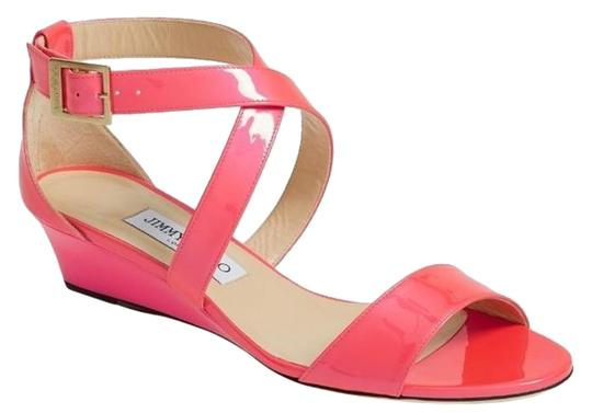 Preload https://item2.tradesy.com/images/jimmy-choo-pink-neon-patent-chiara-strappy-low-sandals-wedges-size-us-75-regular-m-b-13387501-0-1.jpg?width=440&height=440