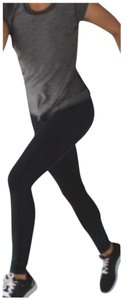 Lululemon New With Tags Lululemon Lights Out speed Tight Iv Black And Forage Teal Size 4