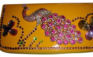 Swarovski Swarovski encrusted yellow zip around long wallet