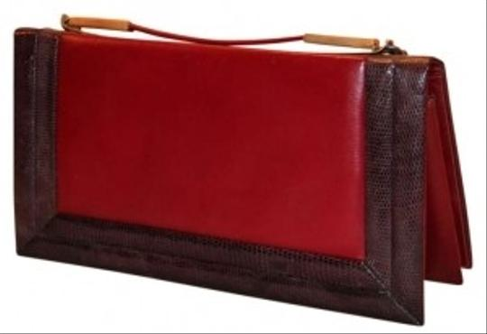 Preload https://img-static.tradesy.com/item/134068/red-snake-fossil-trimmed-with-a-grape-amethys-garnetburgundy-leather-clutch-0-0-540-540.jpg