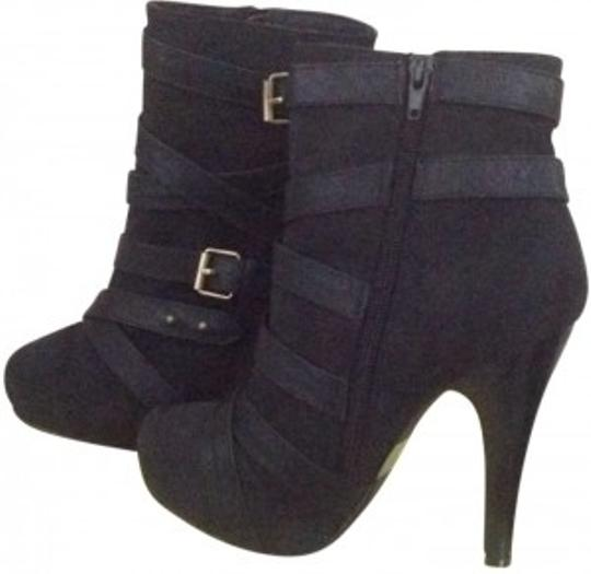 Preload https://img-static.tradesy.com/item/134173/black-ankle-buckled-ankle-bootsbooties-size-us-75-0-0-540-540.jpg