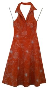 Speechless short dress Orange & White Halter-top Summer Floral Pattern on Tradesy