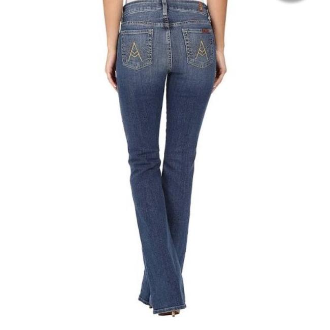 Preload https://item2.tradesy.com/images/7-for-all-mankind-light-wash-a-pocket-boot-cut-jeans-size-27-4-s-1343781-0-1.jpg?width=400&height=650