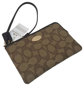 Coach 888067790917 Wristlet in KHAKI / BROWN