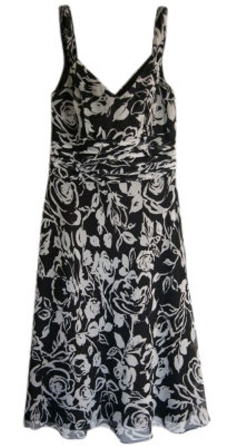 Preload https://img-static.tradesy.com/item/13442/ann-taylor-black-and-white-lined-floral-print-flattering-a-line-cut-above-knee-night-out-dress-size-0-0-650-650.jpg