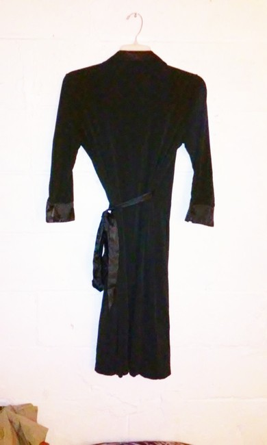 George short dress Black Wrap Around Polyester Spandex on Tradesy