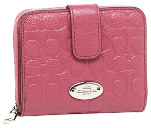 Coach Coach Pebble Leather Signature Embossed Medium Zip Wallet F52861 New With tag.