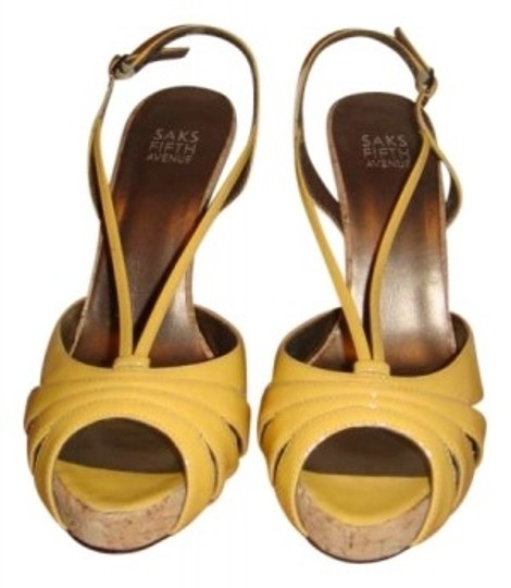 Preload https://item1.tradesy.com/images/saks-fifth-avenue-yellow-patent-name-style-description-leather-straps-with-cork-bottom-sandals-size--134665-0-0.jpg?width=440&height=440