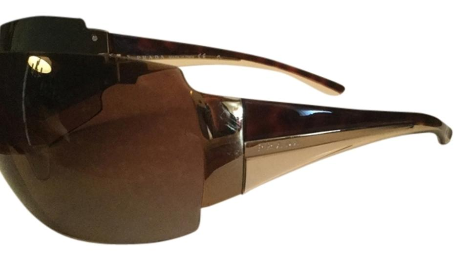 015dcb220db Prada PRADA AVIATOR WRAP AROUND SUNGLASSES Image 0 ...
