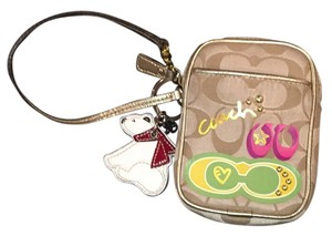 Coach Wristlet in Multi Color With Tan Background