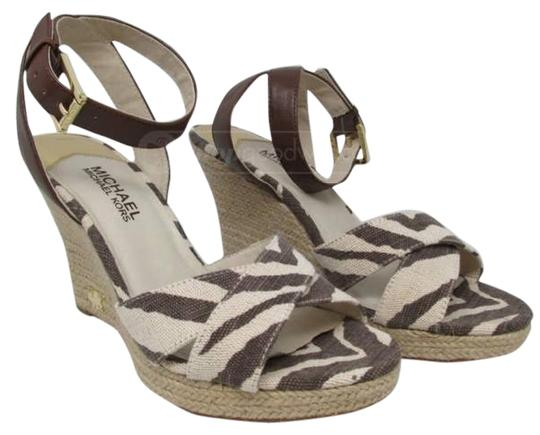 Preload https://item2.tradesy.com/images/michael-kors-brown-and-off-white-animal-wedges-size-us-8-regular-m-b-1348021-0-0.jpg?width=440&height=440