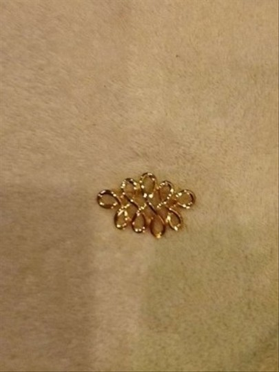 Other Gold colored pin