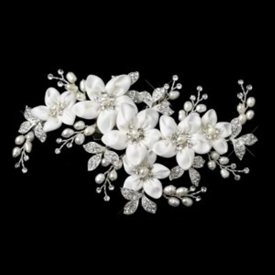 Preload https://item1.tradesy.com/images/elegance-by-carbonneau-ivorysilver-freshwater-pearl-flower-clip-hair-accessory-134955-0-0.jpg?width=440&height=440