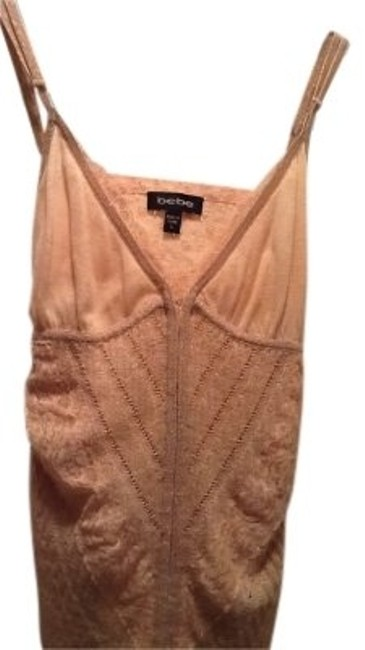 Preload https://item5.tradesy.com/images/bebe-silk-peach-shimmering-knit-lace-material-tank-topcami-size-10-m-135059-0-0.jpg?width=400&height=650