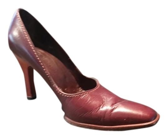 Preload https://img-static.tradesy.com/item/1352984/brown-leather-wooden-heel-pumps-size-us-9-regular-m-b-0-0-540-540.jpg