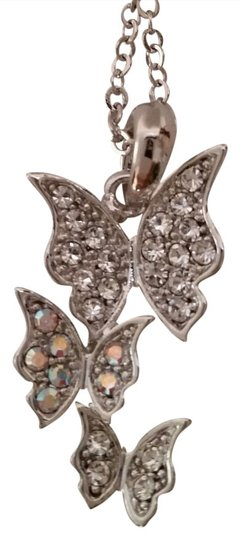 Charming Charlie Butterfly necklace with rhinestones on chain.