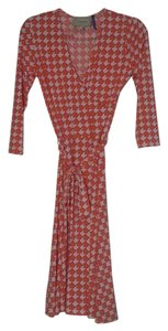 Leota short dress pink and orange print Wrap Belted on Tradesy