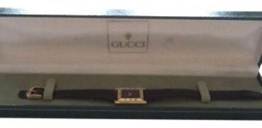 Preload https://item1.tradesy.com/images/gucci-blackgold-ladies-hard-to-find-rectangular-face-watch-135510-0-0.jpg?width=440&height=440
