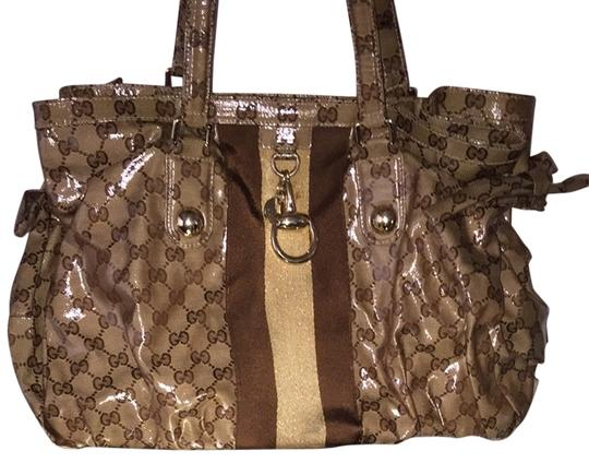 Preload https://item1.tradesy.com/images/gucci-patent-leather-brown-satchel-1357155-0-0.jpg?width=440&height=440