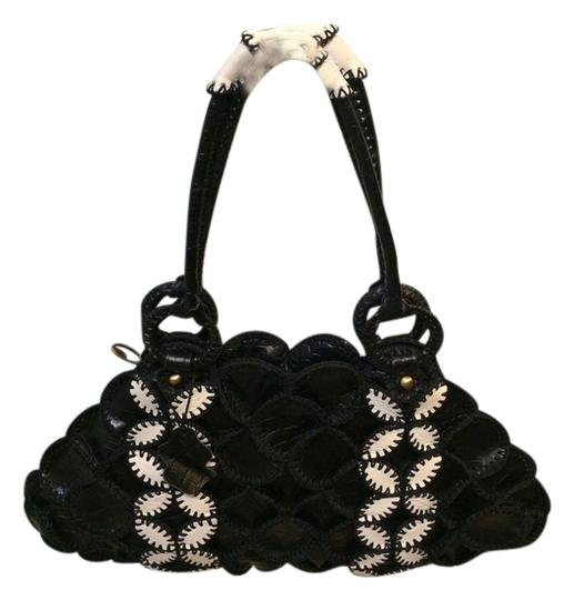 Preload https://img-static.tradesy.com/item/1357792/very-unique-black-and-white-cow-leather-shoulder-bag-0-0-540-540.jpg