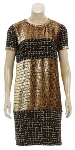 Chanel short dress Gold/Black on Tradesy