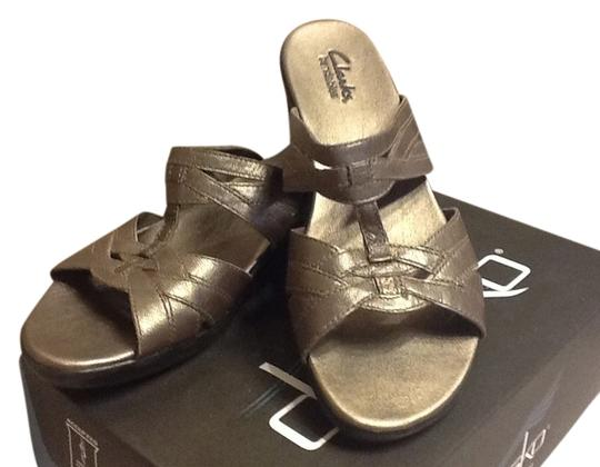 Preload https://item4.tradesy.com/images/clarks-silver-bendables-sandals-size-us-75-1358768-0-0.jpg?width=440&height=440