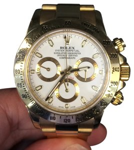 Rolex watch yellow gold Rolex Daytona with a whtie face on a bracelet