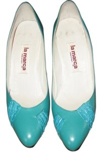 la marca Vintage Leather Teal Pumps