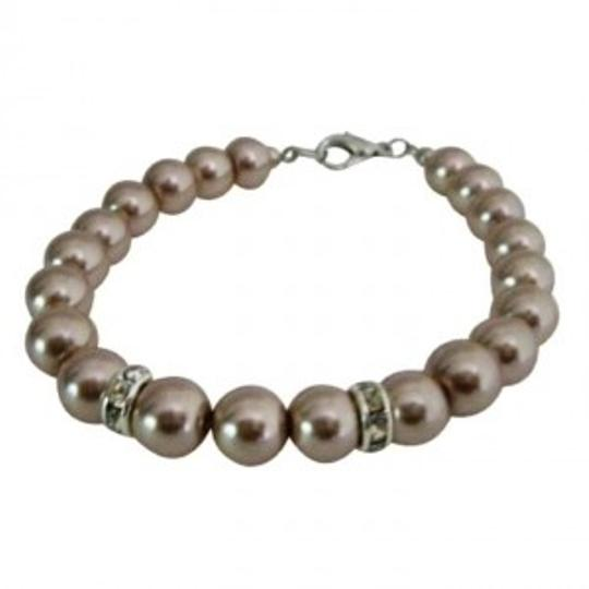Preload https://item5.tradesy.com/images/grey-classy-champagne-pearls-bracelets-very-economical-jewelry-set-136079-0-0.jpg?width=440&height=440