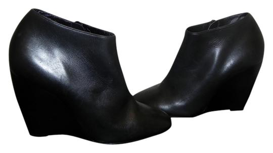 Preload https://item3.tradesy.com/images/pierre-hardy-black-leather-wedge-bootsbooties-size-us-9-regular-m-b-1362362-0-0.jpg?width=440&height=440