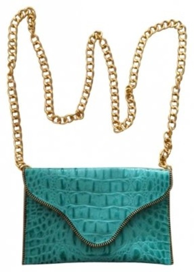 Preload https://item4.tradesy.com/images/jj-winters-mini-zipper-chain-clutchcrocodile-embossed-with-gold-chain-handle-turquoise-leather-cross-136348-0-0.jpg?width=440&height=440