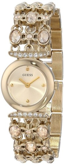 Preload https://item3.tradesy.com/images/guess-gold-female-dress-u0220l2-analog-watch-1363927-0-0.jpg?width=440&height=440